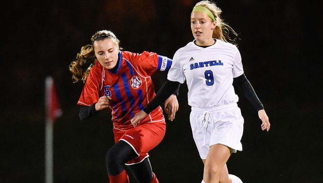 St. Cloud Apollo's Hayley Staska, left, attempts a steal from Sartell's Laura Leonard during the first half Thursday in the Section 8A girls soccer championship at Husky Field.