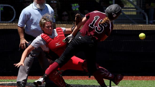 Vernon's Audrey Graf and Mineral Wells catcher Kaitlynn Blue collide at home plate Saturday, May 6, 2017, in Henrietta. The Lady Lions defeated the Lady Rams 6-2.