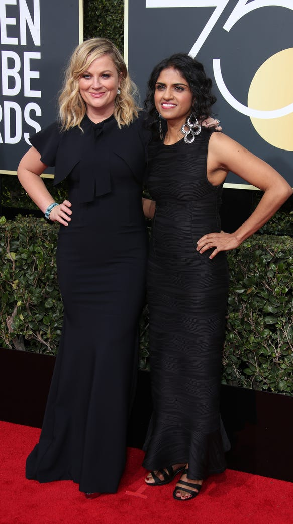 Amy Poehler, left, poses with Saru Jayaraman on the