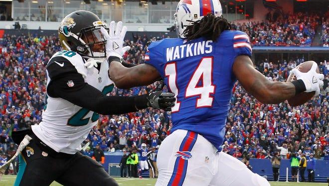 Buffalo Bills wide receiver Sammy Watkins (14) stiff-arms Jacksonville Jaguars cornerback Jalen Ramsey (20) on a 62-yard catch in the third quarter Sunday.