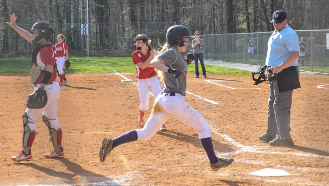Jonnie Petree scores a run in Tuesday's Franklin-North Henderson softball game.