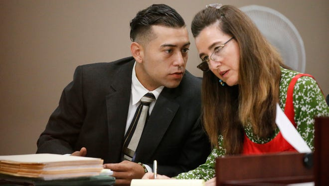 Ricardo Lorenzo Macias Jr. speaks with his attorney, Theresa Caballero, during his murder trial in the 2013 death of Jose Castañon.