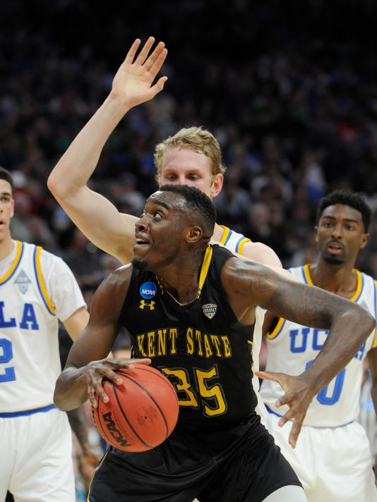 Kent State forward Jimmy Hall, goes to the basket against UCLA center Thomas Welsh during the first half of a first-round game of the men's NCAA college basketball tournament in Sacramento, Calif., Friday, March 17, 2017. (AP Photo/Bryan Patrick)