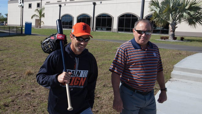 Detroit Tigers manager Brad Ausmus, left, and general manager Al Avila head to spring training Feb. 17, 2017 in Lakeland, Fla.
