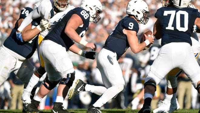 Penn State quarterback Trace McSorley keeps the ball against Pittsburgh in the second half of an NCAA Division I college football game Saturday, Sept. 9, 2017, at Beaver Stadium. Penn State defeated Pitt 33-14.