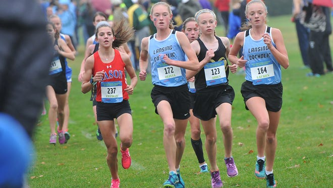 The leaders pass the one-mile mark in the Greater Lansing Cross Country Championships Saturday, October 14, 2017 at Ledge Meadows.