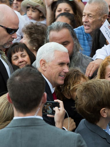 Vice Presidential Candidate, Gov. Mike Pence, takes pictures with supporters after speaking  to a crowd of over 800 supporters at  Las Cruces International Airport, Wednesday November 2, 2016, in Las Cruces New Mexico.