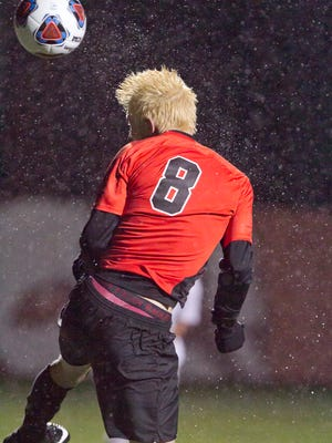 Brighton's Charlie Sharp takes a shot in a 1-0 overtime loss to Portage Central in the regional semifinals on Tuesday, Oct. 24, 2017.