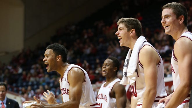 """Hoosiers, l-r, James Blackmon Jr., Kevin """"Yogi"""" Ferrell, Collin Hartman and Nick Zeisloft celebrate teammate Nate Ritchie's slam dunk in the closing seconds of a win over the Timberwolves. Indiana hosted Northwood at Assembly Hall on Thursday, November 6, 2014."""