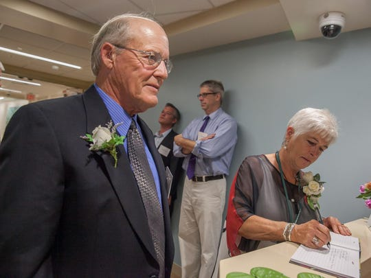 Glen and Rosemarie Wright sign the guest book after a tour of the new UVM Medical Center Maternity ward bearing their names.