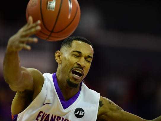 Evansville's Ryan Taylor is fouled on a layup attempt