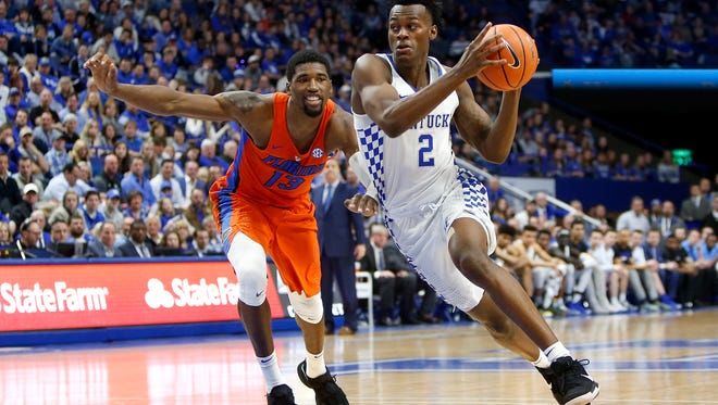 Jarred Vanderbilt, No. 2 of the Kentucky Wildcats, drives to the basket Kevarrius Hayes, No. 13 of the Florida Gators, at Rupp Arena on January 20, 2018 in Lexington, Kentucky.