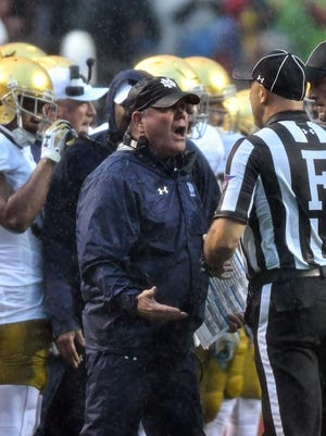 Notre Dame Fighting Irish head coach Brian Kelly argues a penalty call in the first quarter against the North Carolina State Wolfpack at Carter-Finley Stadium.