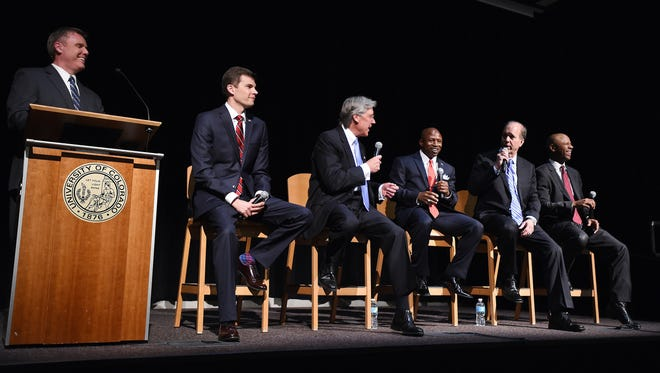 FILE - In this Wednesday, June 8, 2016, file photograph, Republican U.S. Senate hopefuls from left, Jon Keyser, Jack Graham, Darryl Glenn, Robert Blaha and Ryan Frazier debate as moderator Don Ward, far left, smiles at University of Colorado Colorado Springs in Colorado Springs, Colo. The five candidates will face off in Tuesday's primary election for one to earn the right to face incumbent Sen. Michael Bennet in the November general election.