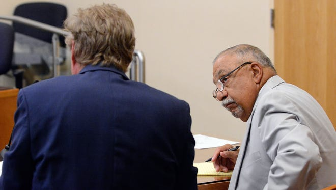 Former Sen. Phil Griego looks to his attorney Thomas Marks during his hearing in District Court, Tuesday, July 5, 2016 in Albuquerque, N.M. District Court began hearing testimony from state lawmakers on accusations that former Sen. Phil Griego used his public office to profit from the sale of a state-owned building.