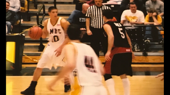 Cedar Grove's Rob Gogerty (left), seen playing for UMBC, is guarded by future NBA player JJ Barea.