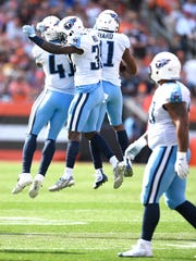 Titans safety Kevin Byard (31) celebrates his interception with teammates during the second quarter  at FirstEnergy Stadium Sunday, Oct. 22, 2017 in Cleveland, Ohio.