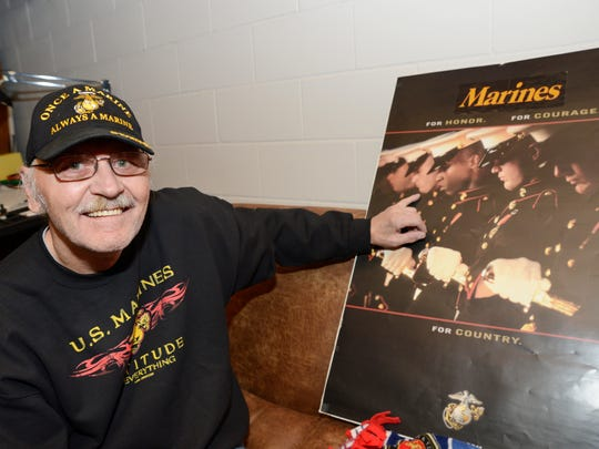 """Manitowoc resident Tony Packowski was in a U.S. Marines recruitment poster during the Vietnam War. It states """"For Honor. For Courage. For Country."""""""