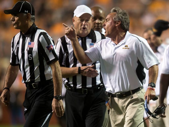 Southern Mississippi head coach Jay Hopson exchanges