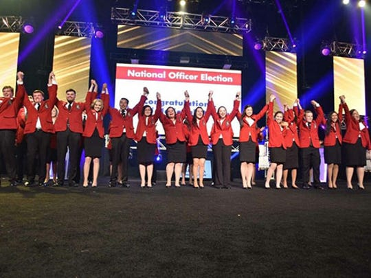 Dixie State University student Madison Whitney and her peers celebrate being elected to the team of SkillsUSA national officers during the organization's election night in 2017