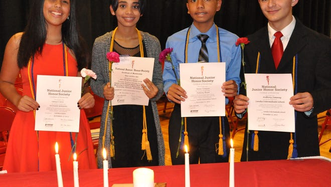 Students from Landis, Rossi, Veterans Memorial and Wallace middle schools were inducted as new members of the National Junior Honor Society recently. (From left) Chapter presidents Omarly Cruz from Veterans Memorial, Brianna Lagarez from Wallace, James Virtucio from Rossi and Anthony Jimenez from Landis spoke on the organization's ideals.