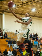 Parkside forward Colen Gaynor (12) works to the basket for a lay up in the season opener against Easton.