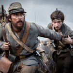 "Matthew McConaughey and Jacob Lofland in a scene from ""The Free State of Jones."""