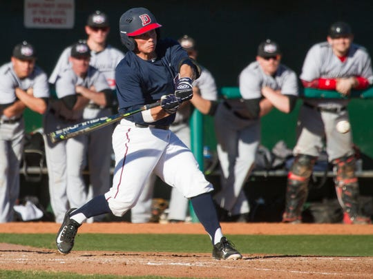 Dixie State's Reece Lucero takes a swing during the