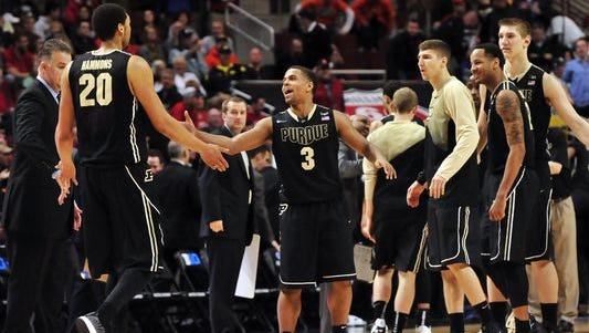 Purdue guard P.J. Thompson (3) celebrates with center A.J. Hammons (20) entering a timeout against Wisconsin in the first half.