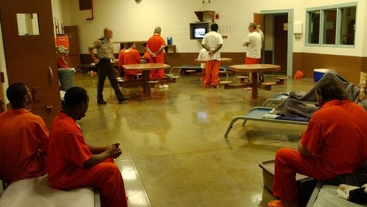 Inmates inside the non-smoking general population area in the men's section at the Clark County Jail in Jeffersonville, Ind.