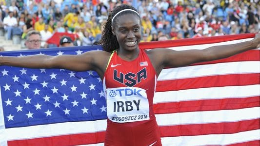 Pike sprinter Lynna Irby celebrates her silver medal at the under-20 World Junior Championships.