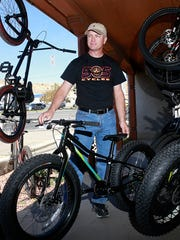 Mike Wulfert stands outside 505 Cycles on Wednesday