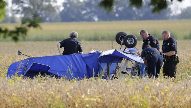 Authorities investigate a plane crash Tuesday, Sept. 12, 2017, in a field along County G in the Winnebago County town of Vinland.