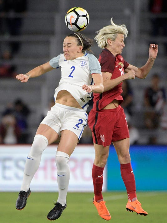 England defender Lucy Bronze (2) and United States midfielder Megan Rapinoe (15) battle for a header during the first half of a SheBelieves Cup women's soccer match Wednesday, March 7, 2018, in Orlando, Fla. (AP Photo/Phelan M. Ebenhack)