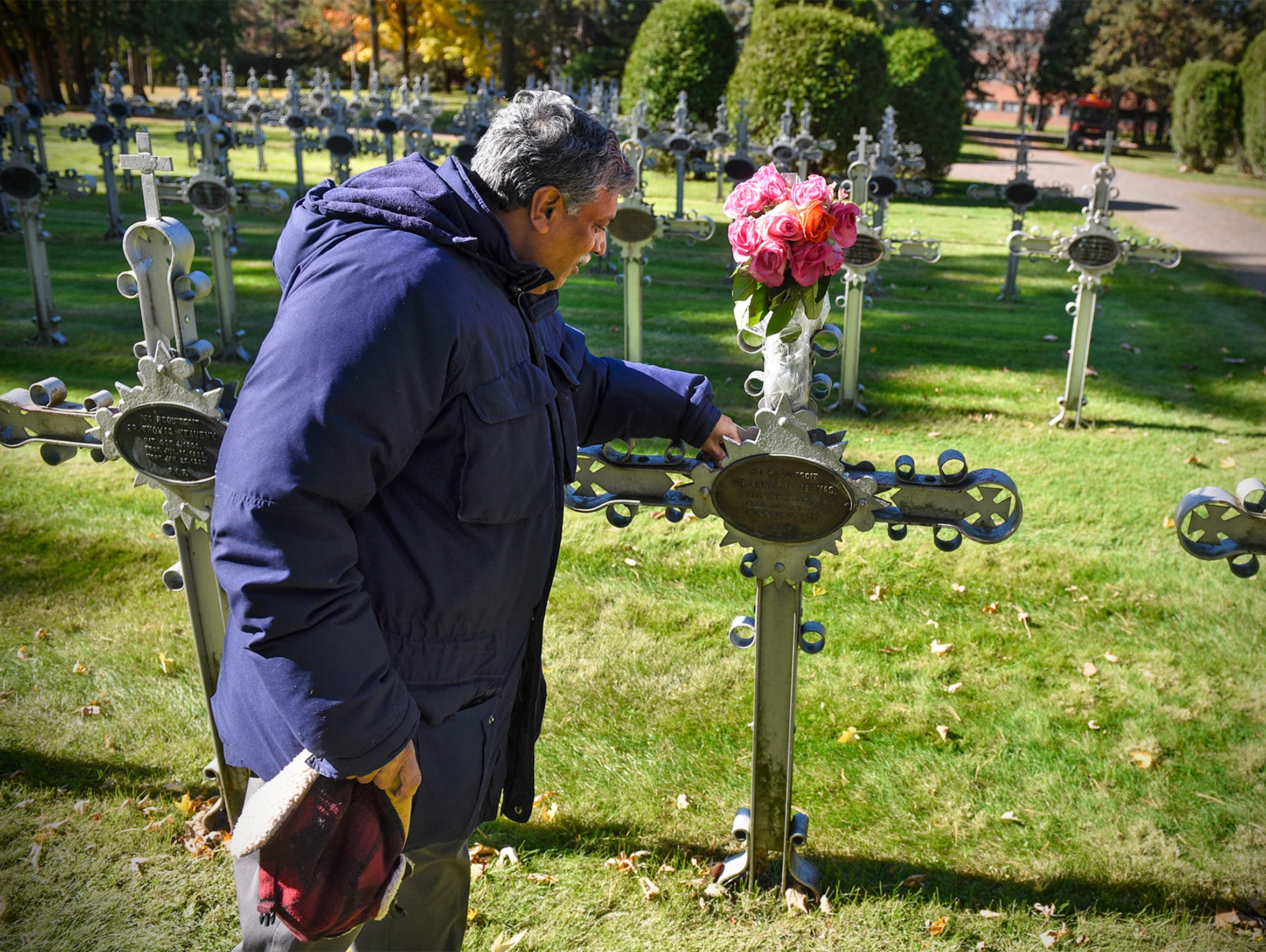 Patrick Norton visits the grave of Sister M. Annella