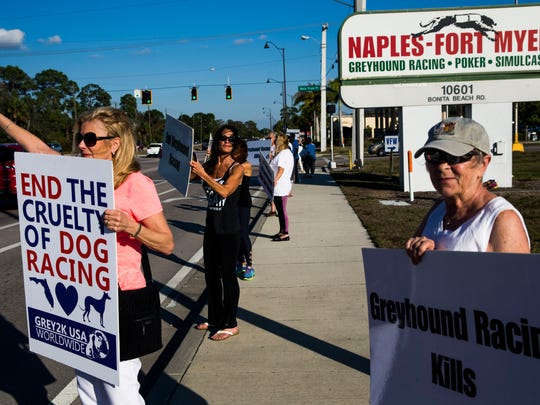A group of GREY2K USA Worldwide volunteers protest outside of the Naples-Ft. Myers Greyhound Race Track in Bonita Springs on Saturday, Jan. 21, 2017.