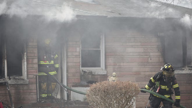 Firefighters on a scene of house fire at 500 block of Main Street in Cedarville, Friday afternoon.  Feb. 12, 2016
