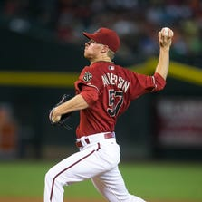 Diamondbacks' Chase Anderson pitches in the first inning against the Rockies at Chase Field in Phoenix, AZ on Sunday, August 31, 2014.