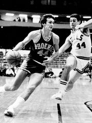 Suns' Paul Westphal (44) drives toward the basket as