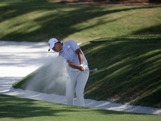 Si Woo Kim of South Korea, hits from the ninth fairway, during the final round of The Players Championship golf tournament Sunday, May 14, 2017, in Ponte Vedra Beach, Fla. (AP Photo/Lynne Sladky)