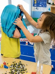 Logan Gregory, 5, and Aubrey Dingman, 5, play in Susie