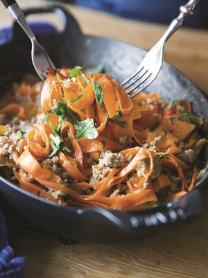 Fresh carrot ribbons are tossed in to this Thai turkey dish to help soak up the sweet, spicy, salty sauce.