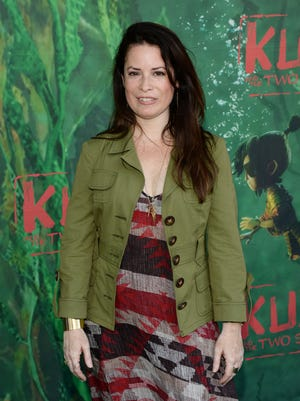 Holly Marie Combs, seen in 2016, tweeted her displeasure with CW's plans to reboot 'Charmed.'