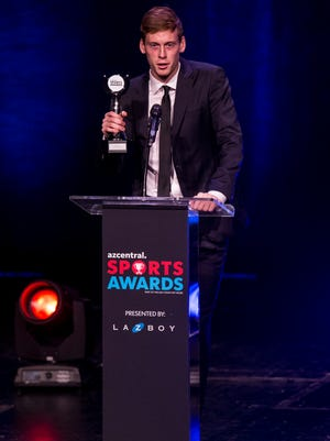 Brophy's Carter Clemmensen accepts the award for Boys Soccer Player of the Year during the azcentral Sports Awards at ASU Gammage in Tempe June 10, 2018.