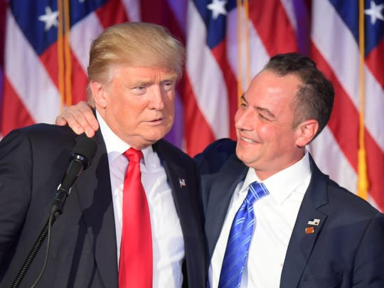 Reince Priebus (right) embraces President Donald Trump on election night in 2016.