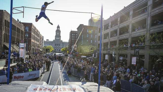 Renaud Lavillenie of France clears the bar in the opening rounds of the Pole Vault on Court Ave in downtown Des Moines, Iowa, as part of the Drake Relays Wednesday April 22, 2015.