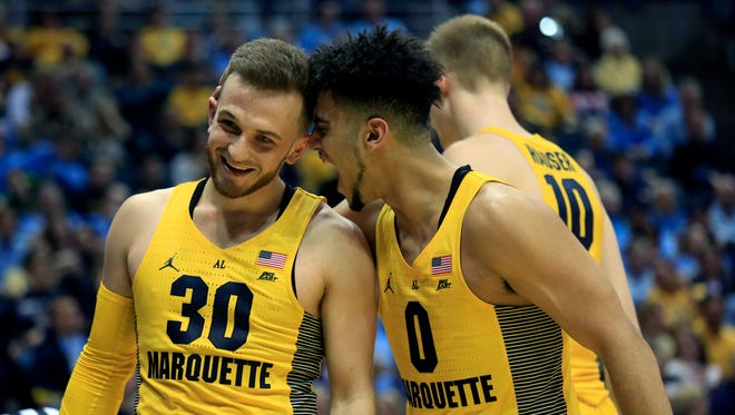 Marquette guard Markus Howard, screams in the ear of Andrew Rowsey during a big victory over Xavier.