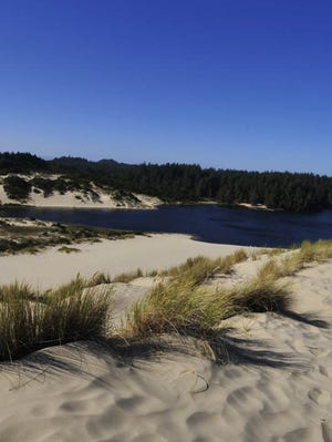 The Oregon Dunes set against a bright blue sky on a windy day at Jessie M. Honeyman Memorial State Park near Florence Thursday, Sept. 1, 2011. There are two miles of sand dunes between the park and the ocean and two natural freshwater lakes are within the park.