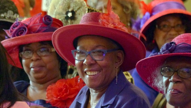 """Audience members applaud and laugh along with the antics of some of the models participating in the """"It's All About PIzzazz!!!"""" Hat Show and Luncheon Sunday afternoon at New World Landing."""