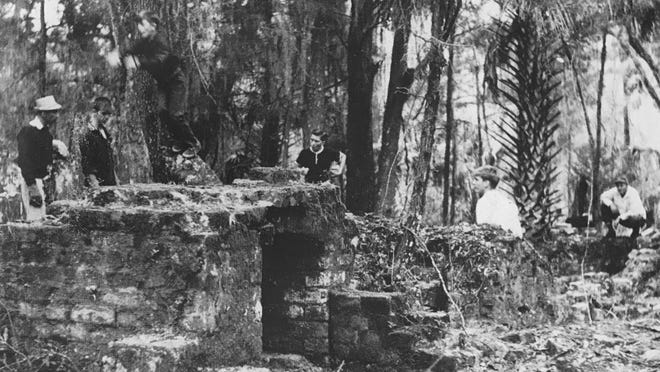 Members of a local Boy Scout troop are shown in the ruins of Joseph M. Hernandez's 200-acre St. Joseph sugar plantation in northern Flagler County in the late 1950s. The ruins were in a series of levels running down a hillside that extended nearly 250 feet. They were destroyed during the development of Palm Coast in the 1970s.